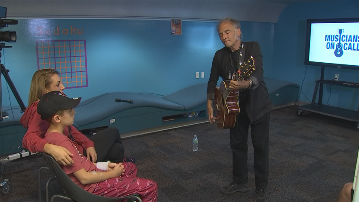 Nils Lofgren sang four songs with his guitar at the Phoenix Children's Hospital. (Source: 3TV/CBS 5)