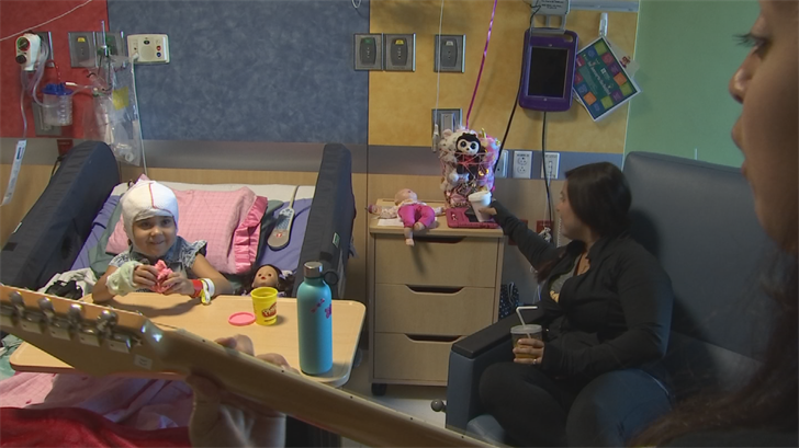 Other volunteers with Musicians on Call visited patients bedside to sing them a song in person. (Source: 3TV/CBS 5)