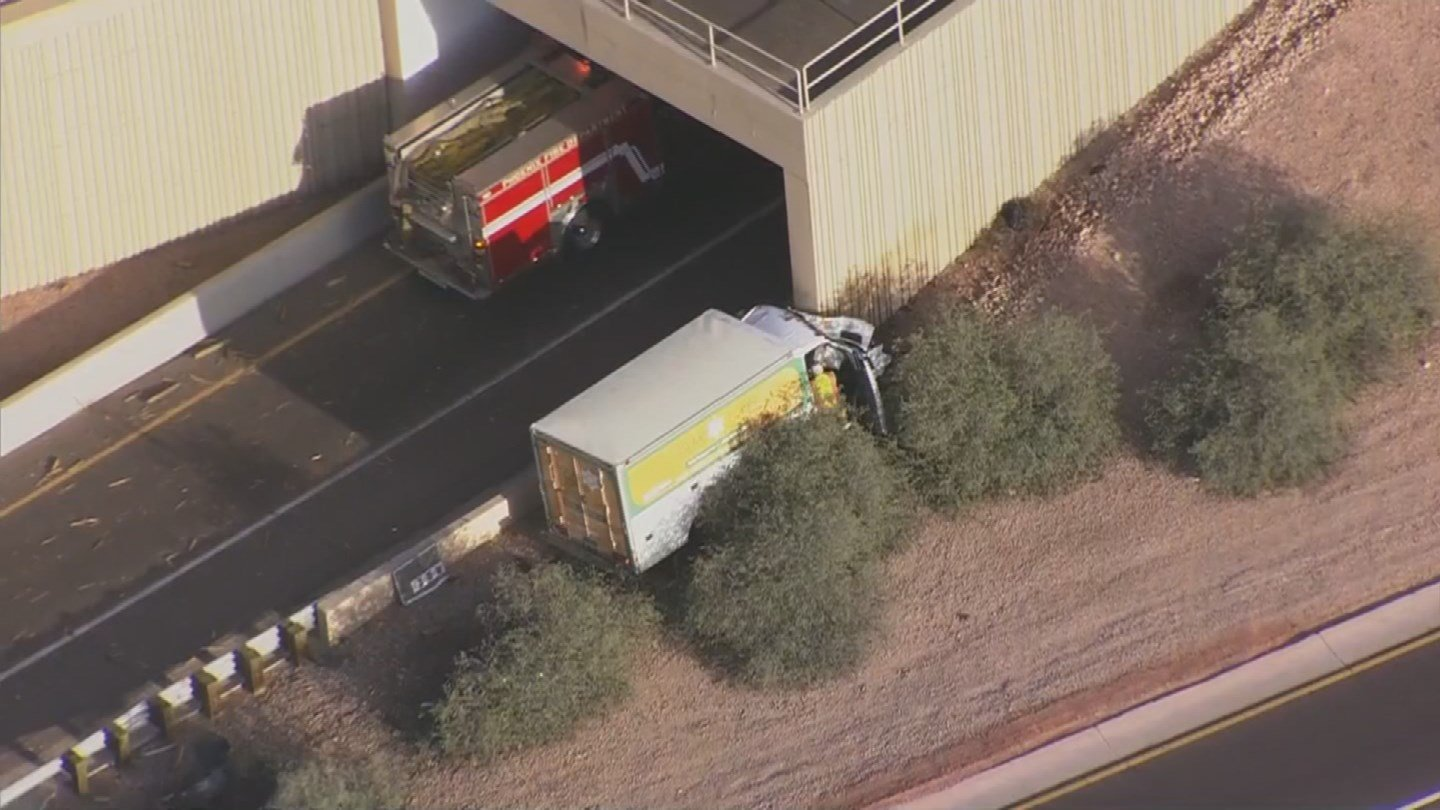 A delivery vehicle crashed into a concrete barrier wall on Interstate 10 closing the on-ramp in Phoenix Wednesday morning. (Source: 3TV/CBS 5)
