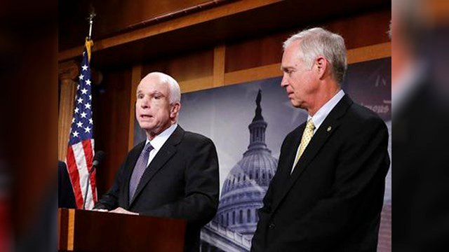 FILE - In this July 27, 2017 file photo, Sen. Ron Johnson, R-Wis. listens as Sen. John McCain, R-Ariz. speaks on Capitol Hill in Washington. (Source: AP Photo/J. Scott Applewhite)
