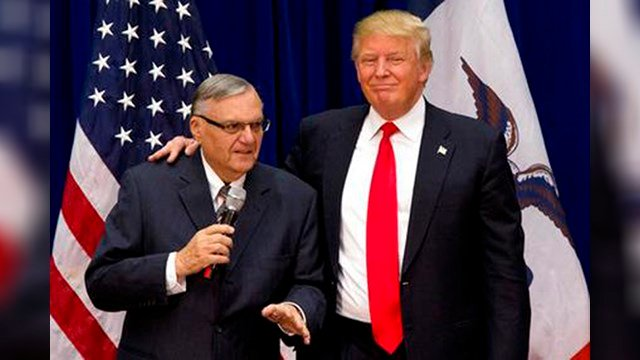 FILE - In this Jan. 26, 2016, photo, Republican presidential candidate Donald Trump is joined by Maricopa County, Ariz., Sheriff Joe Arpaio at a campaign event in Marshalltown, Iowa. (Source: AP Photo/Mary Altaffer, File)