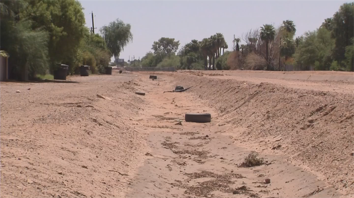 The homeowners contend that the drainage ditch, which parallels the canal, is poorly maintained and that adds to their flooding. (Source: 3TV/CBS 5)
