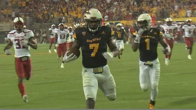 Kalen Ballage scores one of his record-tying eight touchdowns vs Texas Tech. (Source: 3TV/CBS 5)