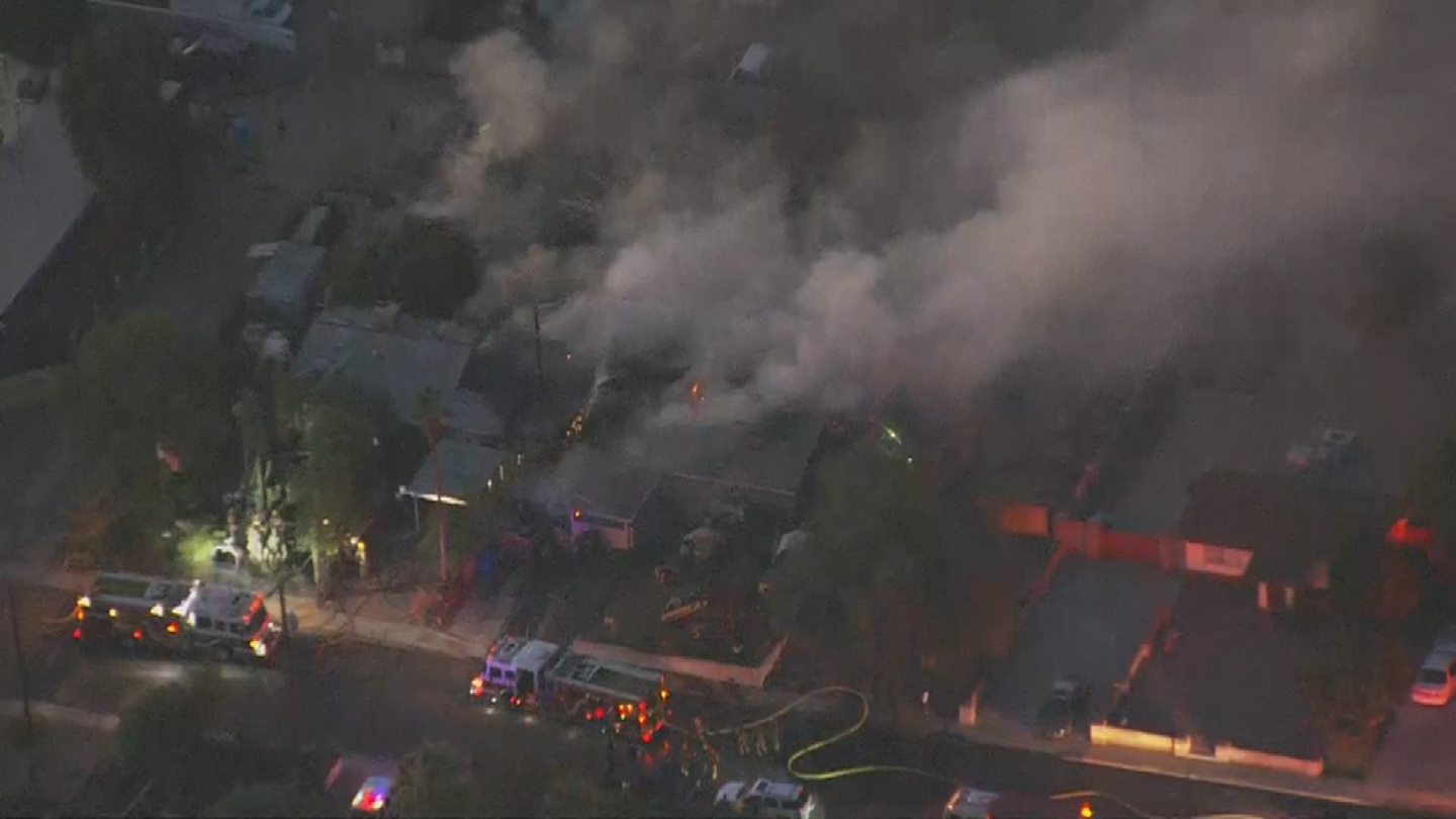 The fire then spread to the attic of a home next door. (Source: 3TV/CBS 5)