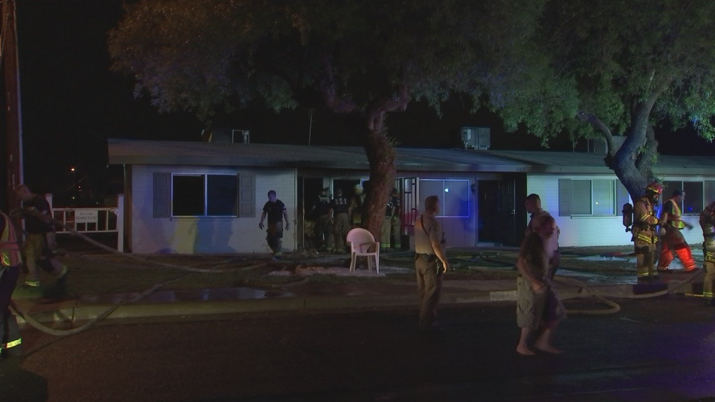 A woman was transported with minor injuries after a house fire in Sun City early Friday morning. (Source: 3TV/CBS 5)