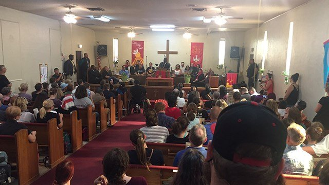 Demonstrators packed a church for a rally against hate. (Source: 3TV/CBS 5)