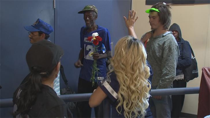 Volunteers also gave the homeless flowers. (Source: 3TV/CBS 5)