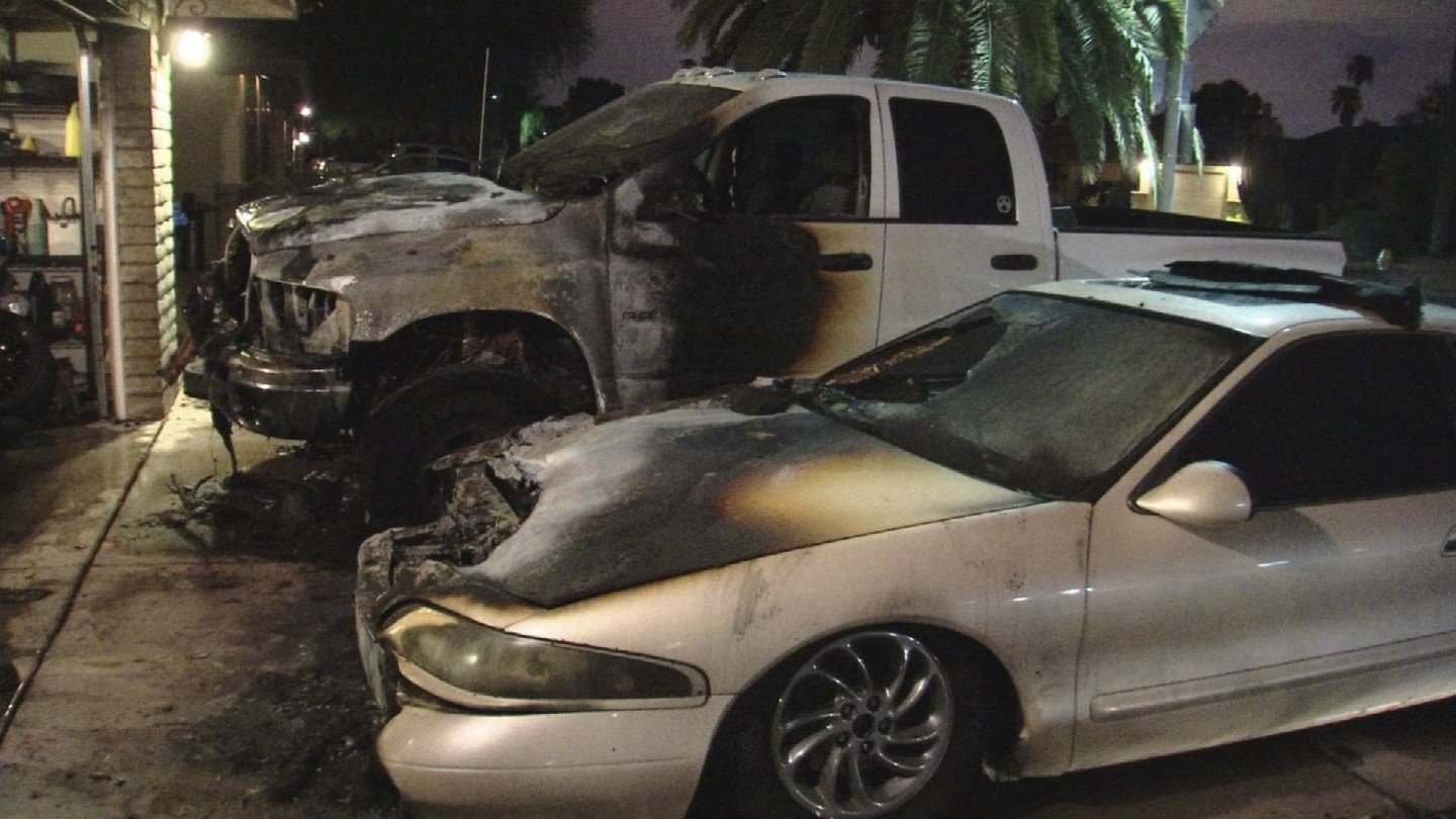 Multiple fire personnel responded to a fire involving two vehicles that caught fire in a Tempe driveway overnight. (Source: 3TV/CBS 5)