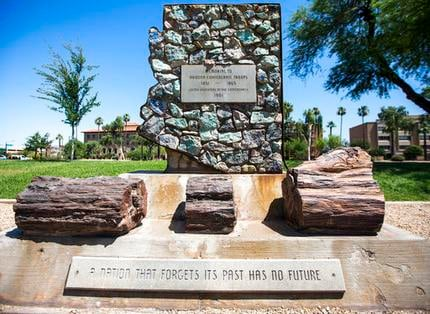 A monument to Arizona Confederate soldiers, presented by the United Daughters of the Confederacy in 1961, amid other memorials at Wesley Bolin Memorial Plaza on the grounds of the Capitol complex in Phoenix (Source: AP Photo/Angie Wang, File)