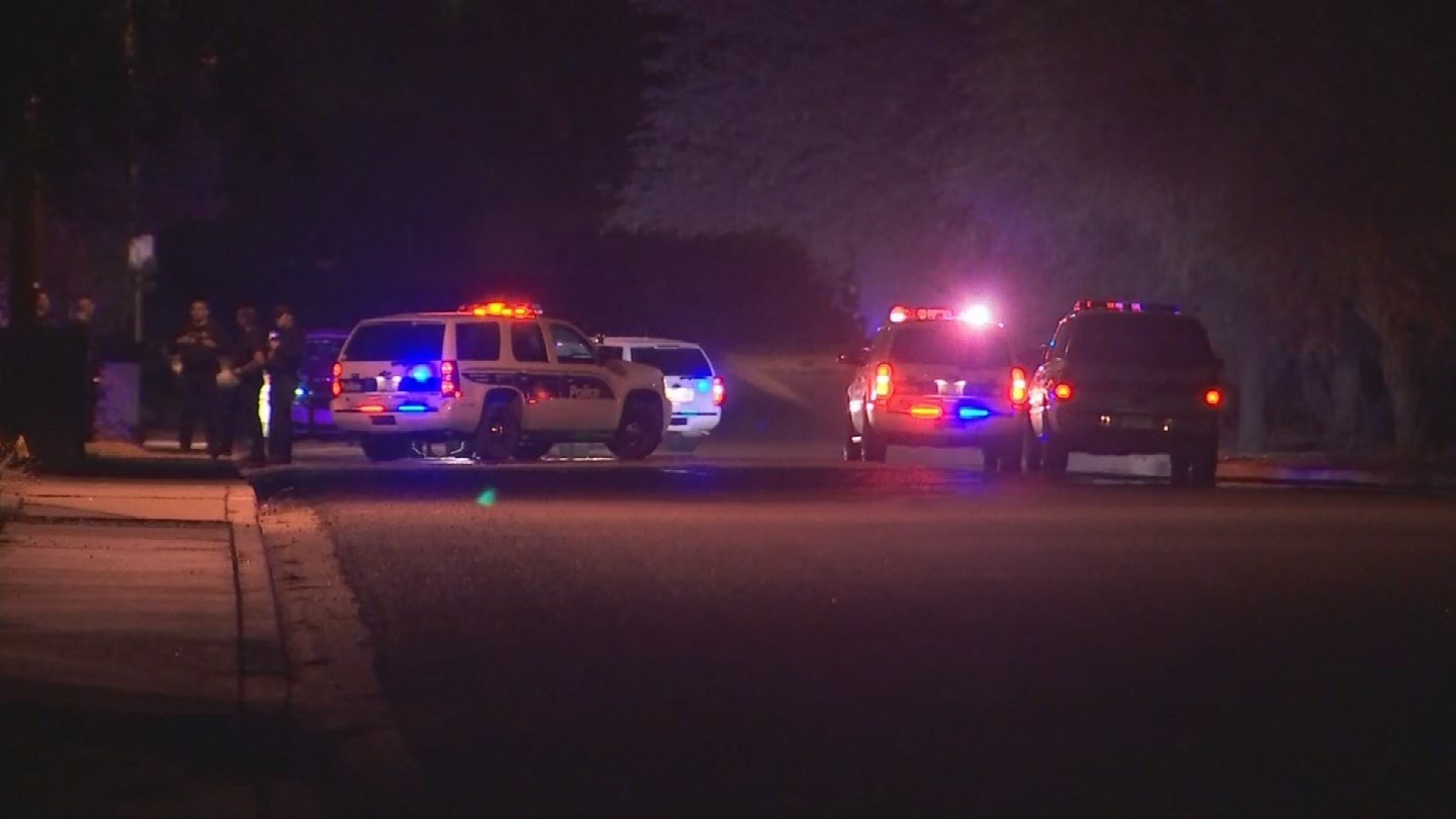 Phoenix police say a 20-year-old man used a kitchen knife to stab his father, an off-duty officer, in the neck in north Phoenix Wednesday morning. (Source: 3TV/CBS 5)
