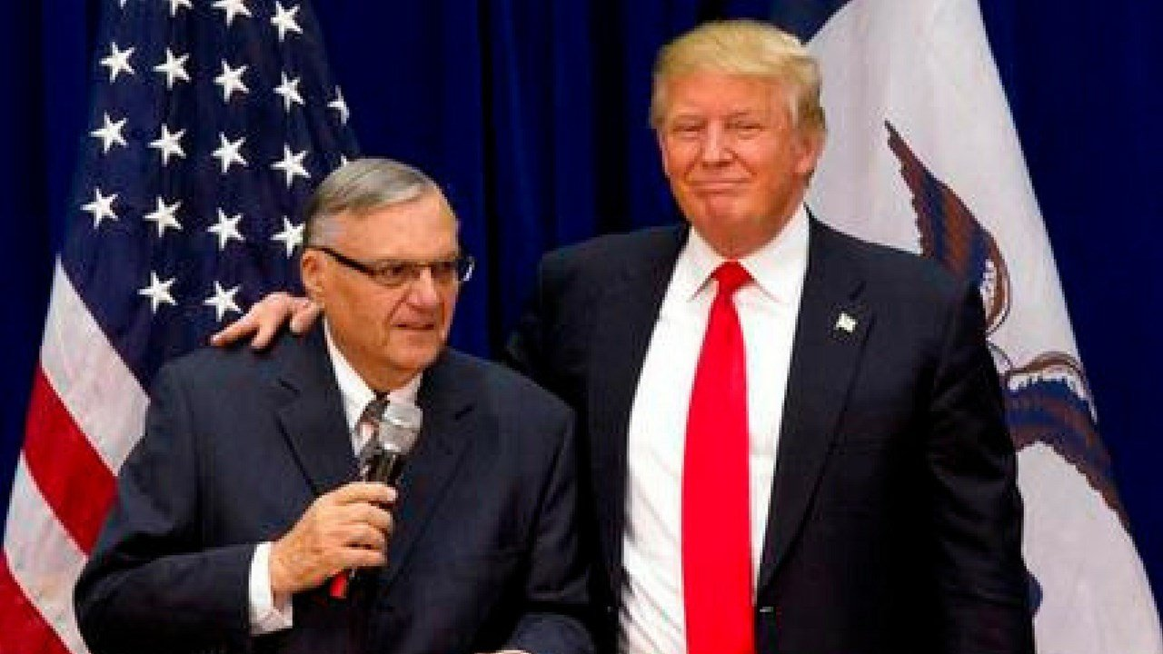 FILE - In this Jan. 26, 2016 file photo, then-Republican presidential candidate Donald Trump is joined by Joe Arpaio, the sheriff of metro Phoenix, at a campaign event in Marshalltown, Iowa (AP Photo/Mary Altaffer, File)