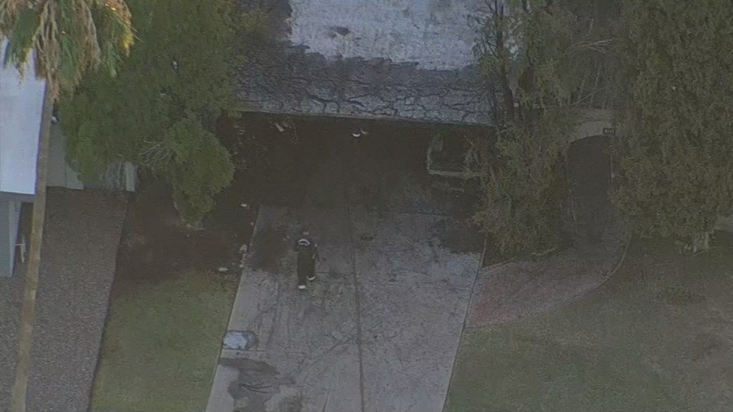 After the neighbors called 911, Phoenix and Scottsdale fire crews quickly responded to the working house fire near Thomas Road and 60th Street. (Source: 3TV/CBS 5)