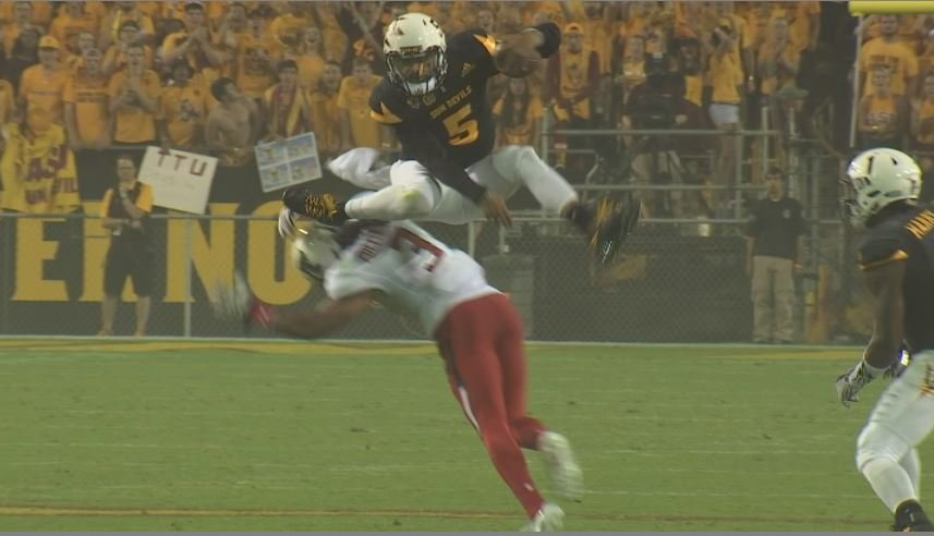Manny Wilkins leaps over a defender during ASU's 2016 win over Texas Tech