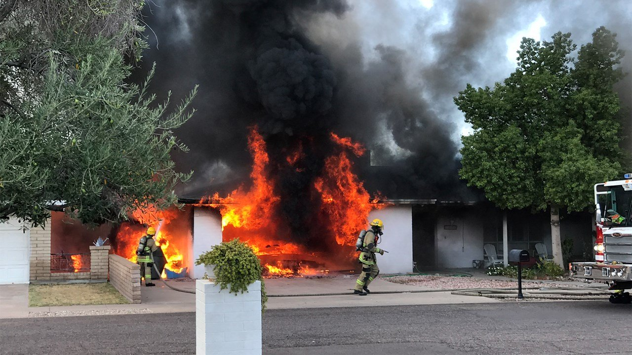 Firefighters said the fire started in the garage. (Source: Susan K. Peacock)