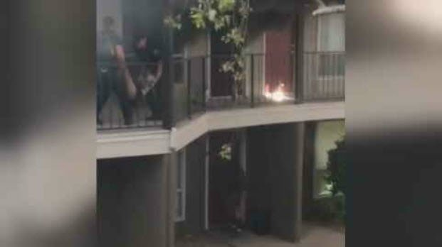 The woman was unconscious at the time she was taken out of the apartment. (Source: 3TV/CBS 5)