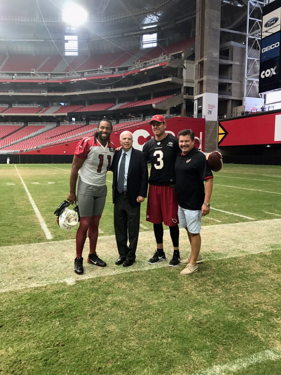 While McCain and Cardinals President Michael Bidwill talked and watched the practice, wide receiver Larry Fitzgerald and quarterback Carson Palmer came over and the four posed for a group photo. (Source: twitter.com/SenJohnMcCain)