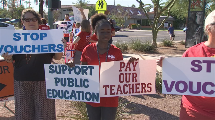 Those against Arizona's new school voucher law held a protest outside the public school that Gov. Doug Ducey visited on Thursday. (Source: 3TV/CBS 5)