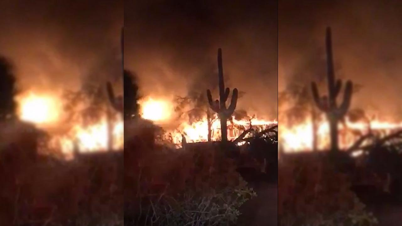 The fire roared through the abandoned home near Mercury Drive and Signal Butte Road as firefighters struggled to initially extinguishbecause of the access to the home, Rural Metro Fire said. (Source: 3TV/CBS 5)