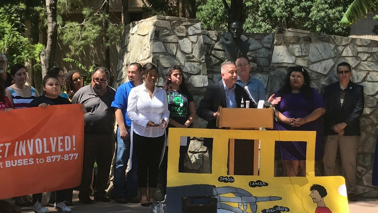 John Gomez, governing board vice president of the Cartwright School District, speaks about the Clean Buses for Healthy Niños campaign outside the state Capitol in Phoenix on Thursday. (Source: Samantha Pouls/Cronkite News)