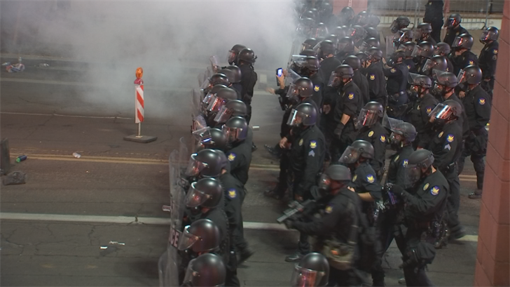 Things got unruly after the rally had ended when police said protesters threw gas and other items at police. (Source: 3TV/CBS 5)