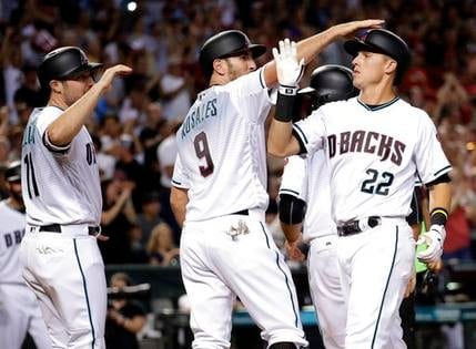 Jake Lamb celebrates with teammates after hitting a grand slam. (Source: The Associated Press)