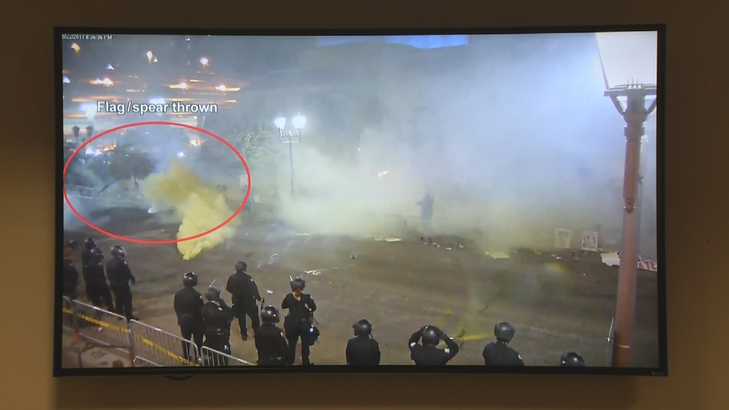 Police said the video shows somebody threw a flag like a spear at officers. (Source: 3TV/CBS 5)