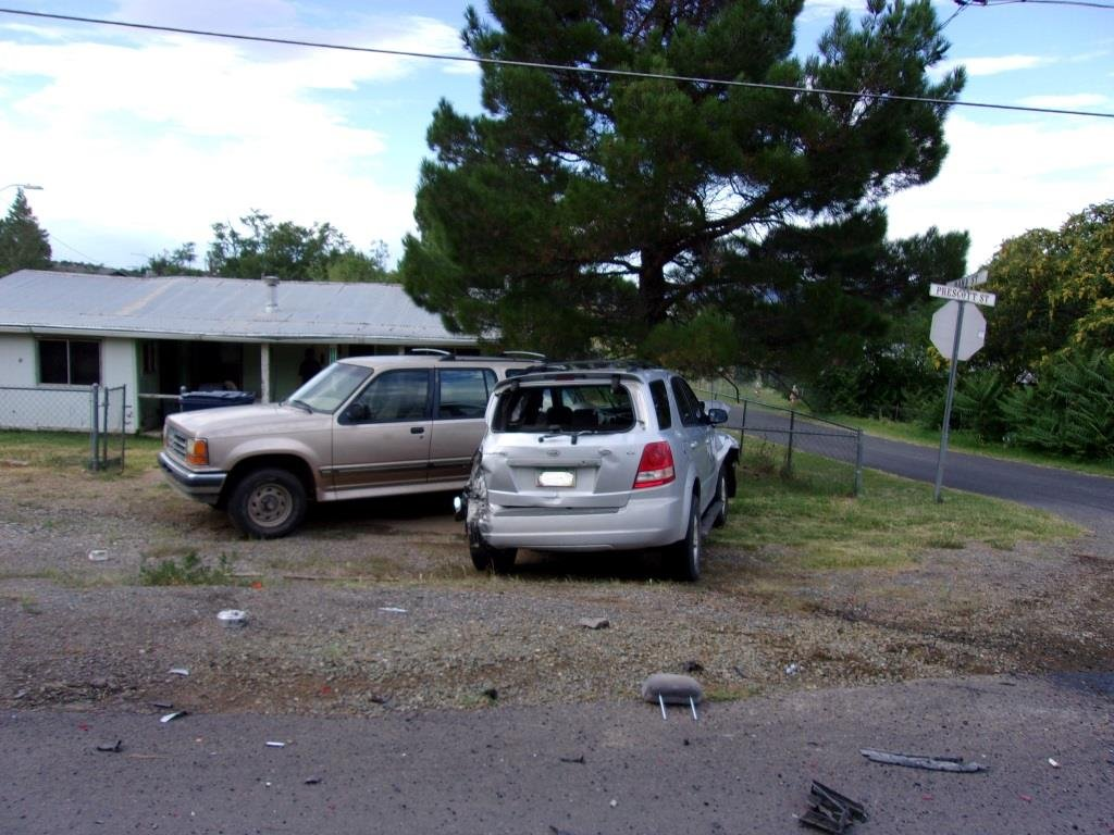 The Kia then struck a parked Ford Explorer, pushing it into a chain-linked fence. (Source: YCSO)