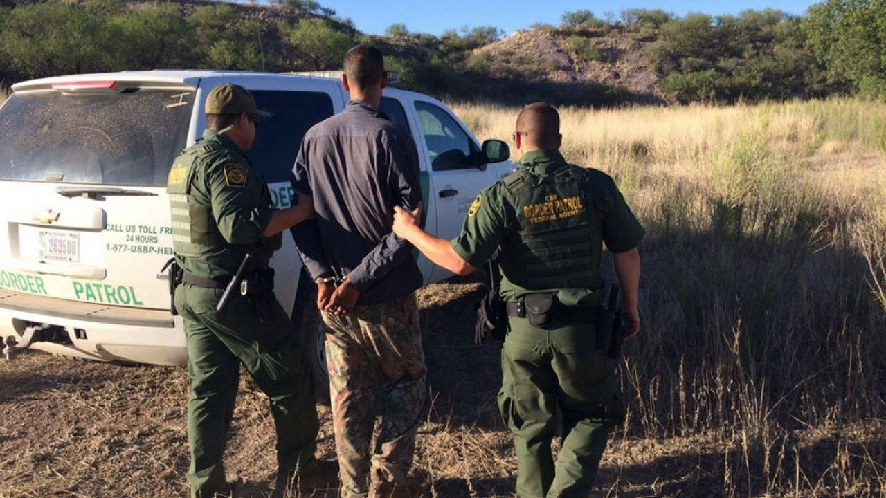 Border Patrol agents arrest a border-crosser in June near a medical aid camp in the desert near Arivaca. (Photo courtesy Customs and Border Protection)