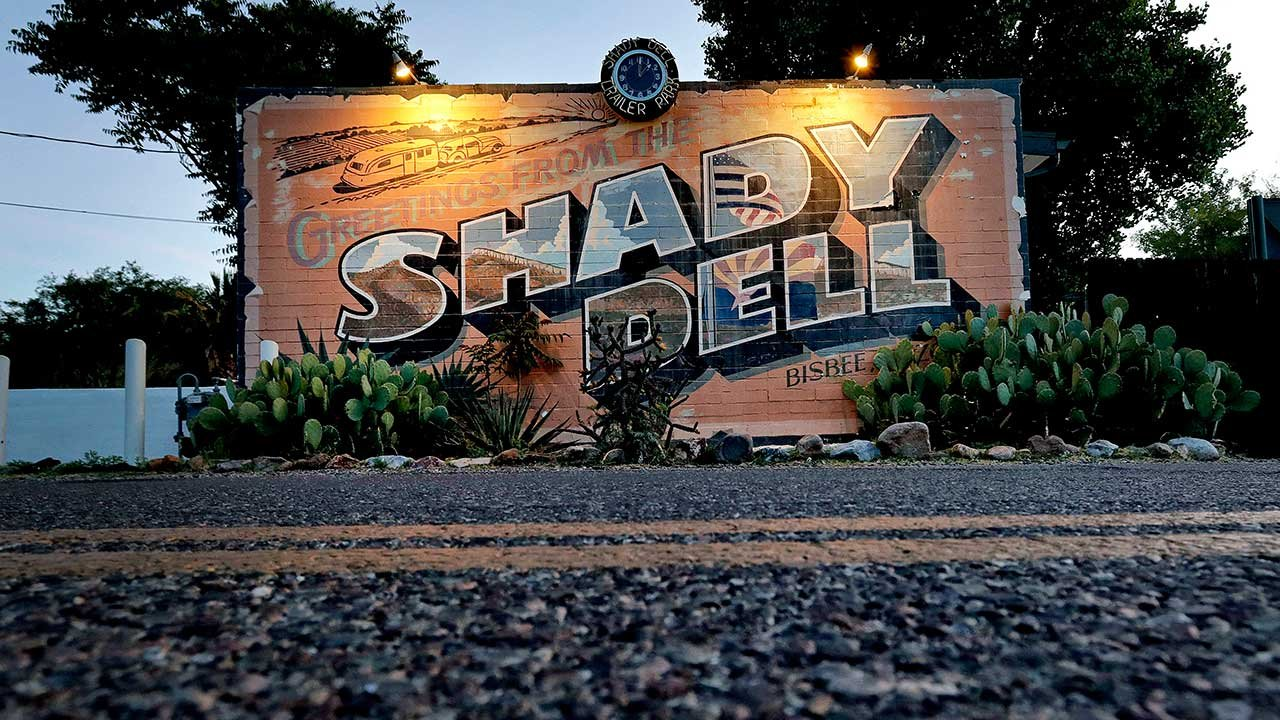 The front office of the Shady Dell trailer court is illuminated at dawn, Wednesday, April 26, 2017, in Bisbee, Ariz. (Source: AP Photo/Matt York)