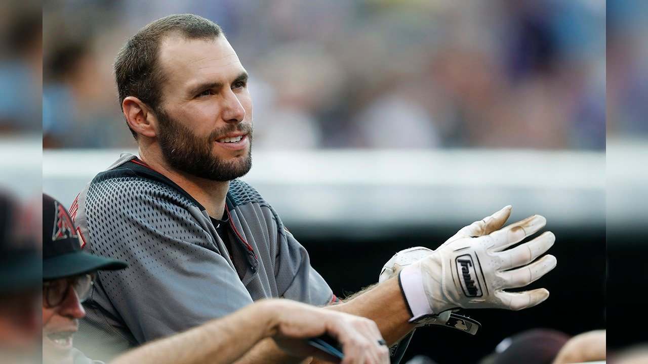 Arizona Diamondbacks' Paul Goldschmidt adjusts his batting gloves as he leans over the dugout rail before batting against the Colorado Rockies in the first inning of a baseball game Saturday, Sept. 2, 2017, in Denver. (Source: AP Photo/David Zalubowski)