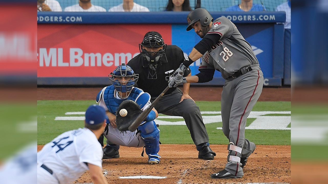 Arizona Diamondbacks' J.D. Martinez, right, hits a two-run home during the fourth inning of a baseball game, Monday, Sept. 4, 2017, in Los Angeles. (Source: AP Photo/Mark J. Terrill)