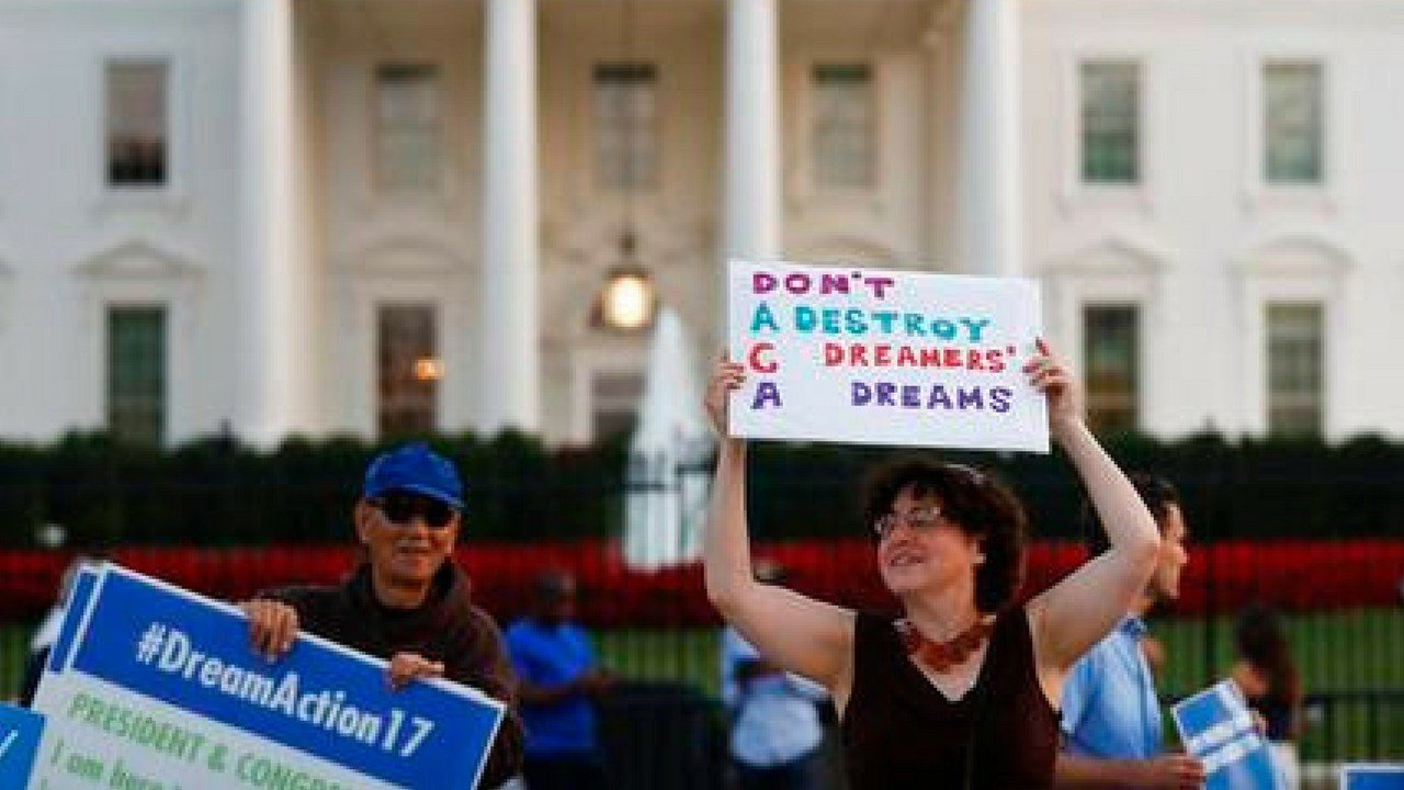 "Julia Paley with the DMV Sanctuary Congregation Network, dances with a sign that reads ""DACA Don't Destroy Dreamers Dreams"" during a rally supporting Deferred Action for Childhood Arrivals, or DACA, outside the White House, (AP Photo/Carolyn Kaster)"