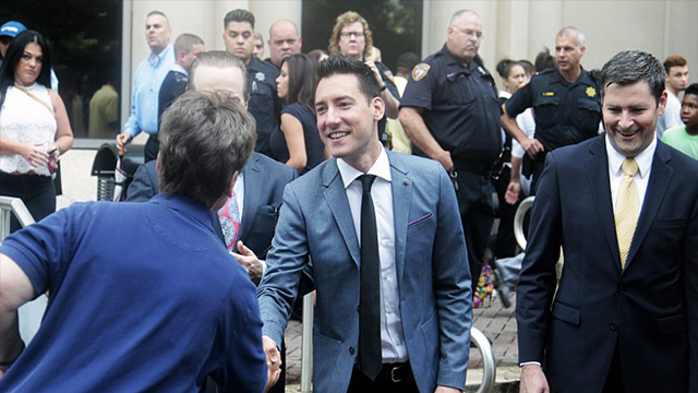 David Daleiden, center, being congratulated by supporters outside court. (Source: AP file photo)