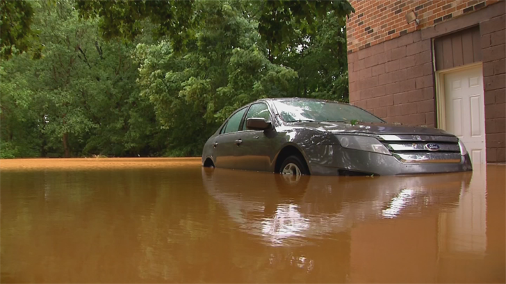 Seeing cars submerged under water or floating down streets was a pretty common sight within the aftermath of hurricane Harvey. (Source: 3TV/CBS 5)