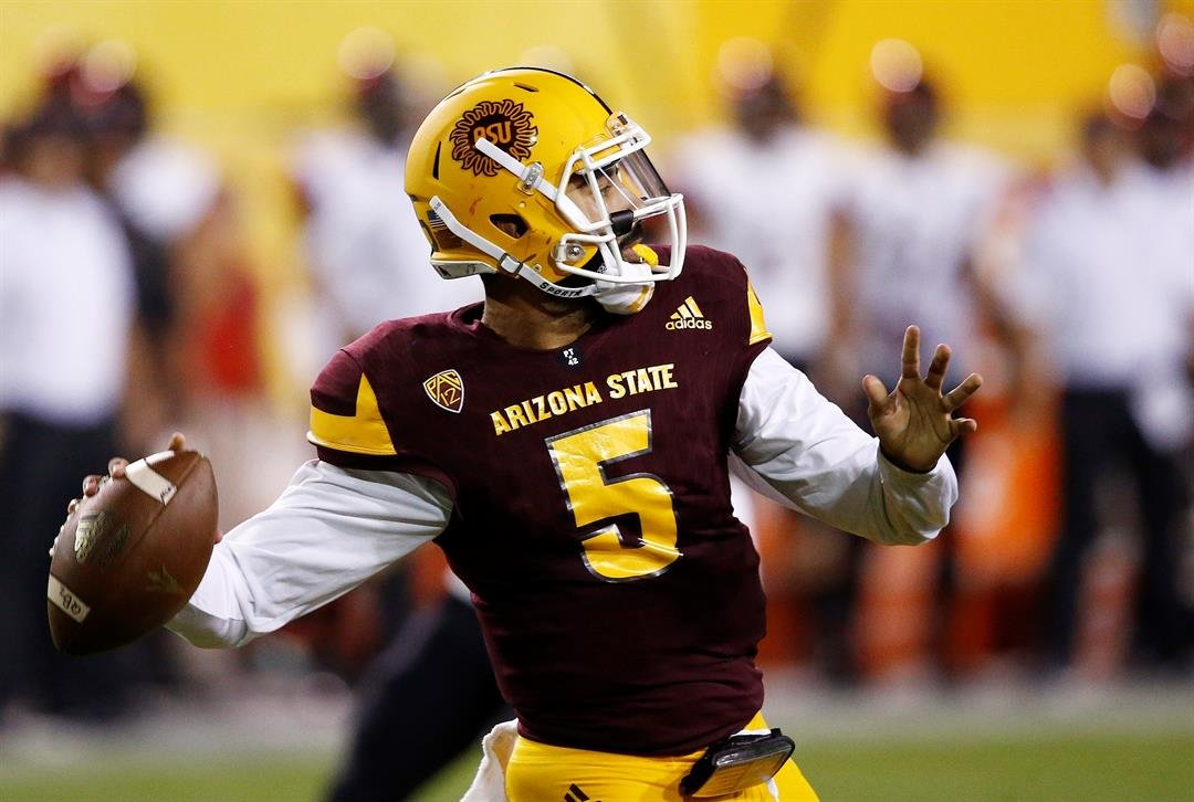 Manny Wilkins throws a pass against San Diego State (AP Photo/Ross D. Franklin)