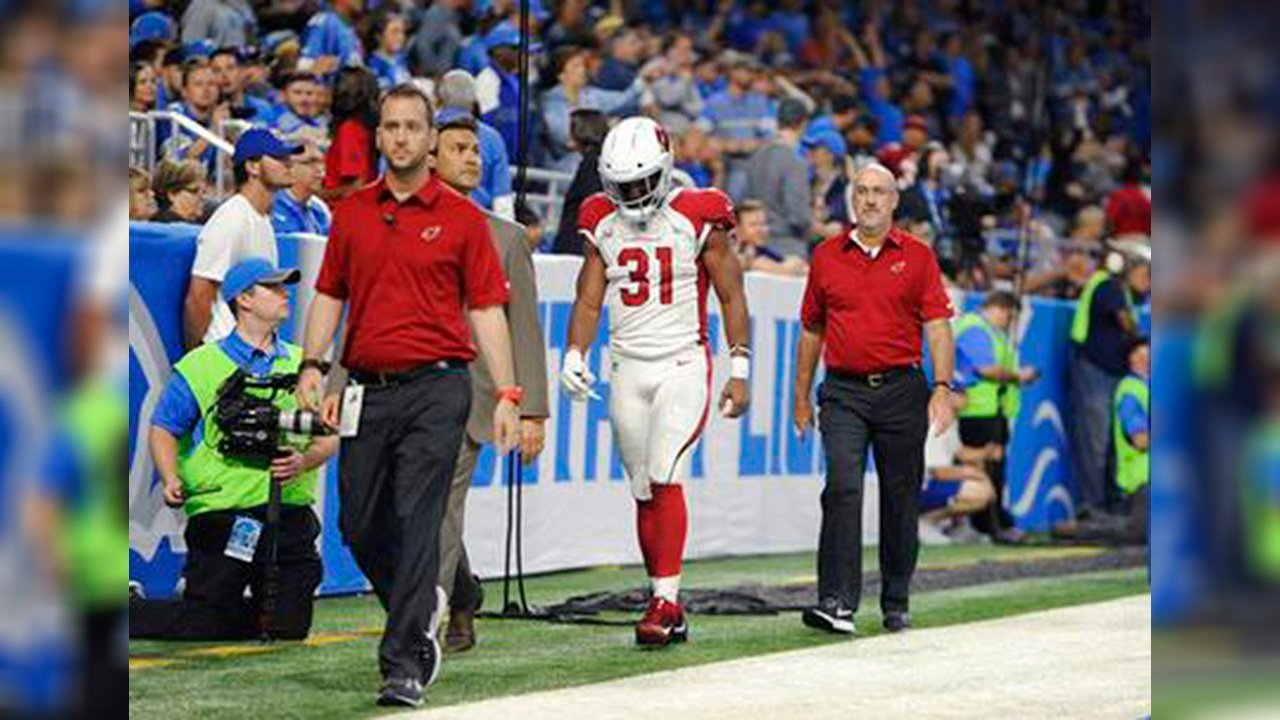 Arizona Cardinals running back David Johnson walks off the field with medical staff for X-rays during an NFL football game against the Detroit Lions in Detroit Sunday Sept. 10 2017