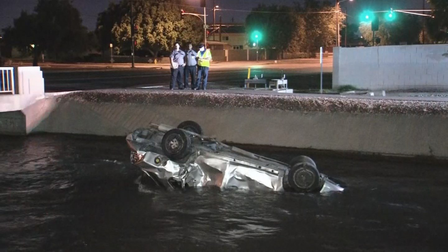Three people are in serious condition after a crash ended with their vehicle upside down in a Phoenix canal. (Source: 3TV/CBS 5)