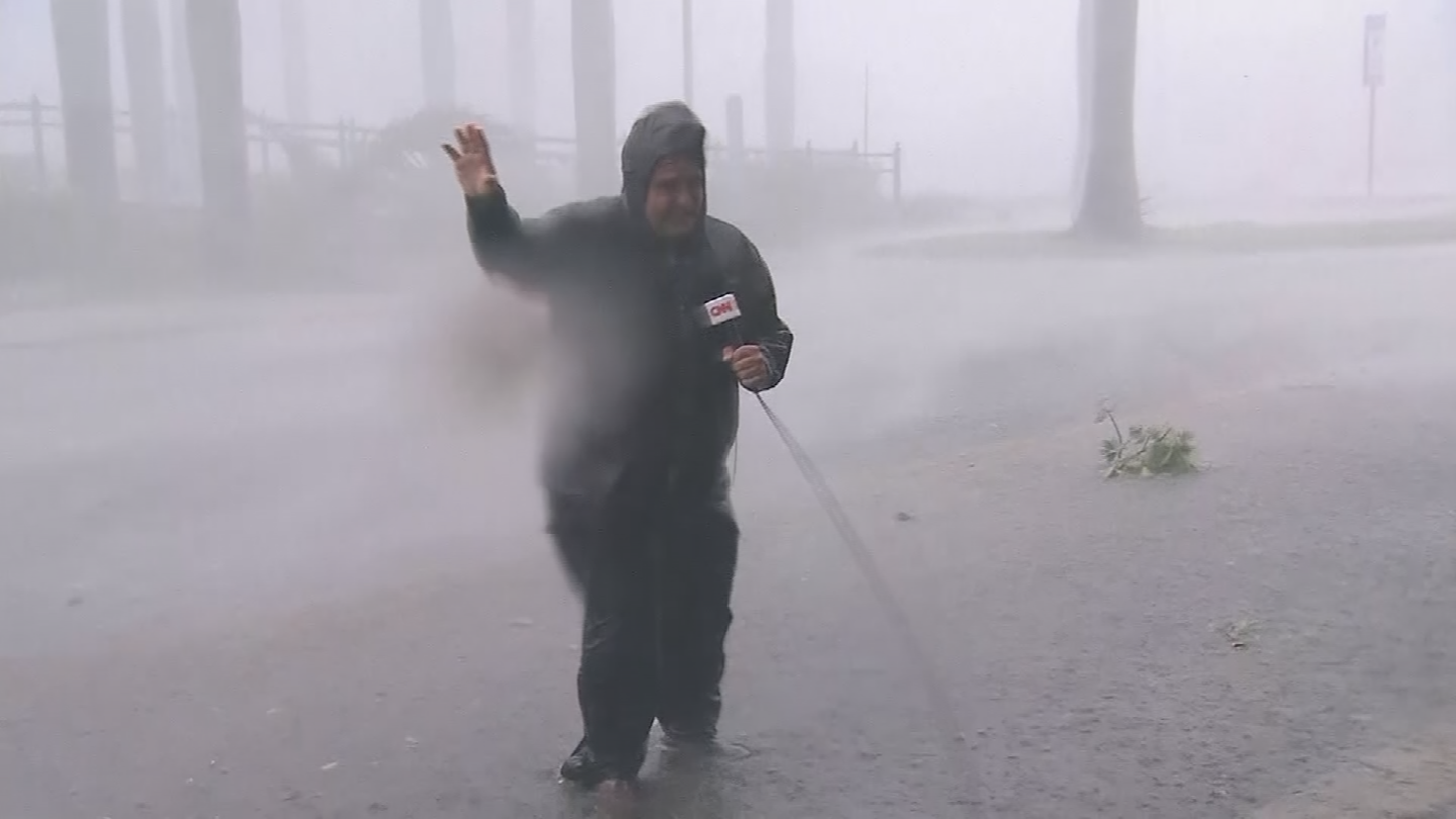 Reporters have been seen braving the hurricane winds but is it necessary? (Source: CNN)
