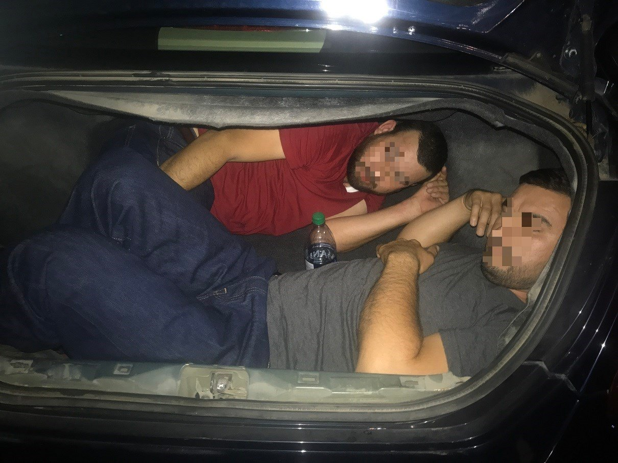 Border Patrol agents say five adults from Mexico have been arrested after trying to cross the Arizona border illegally by hiding in a car's trunk and under its floorboards. (Source: CBP)