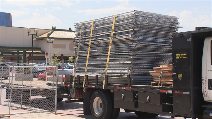 Before crews could finish the fencing, the City of Phoenix shut down the crews because they didn't have permits. (Source: 3TV/CBS 5)