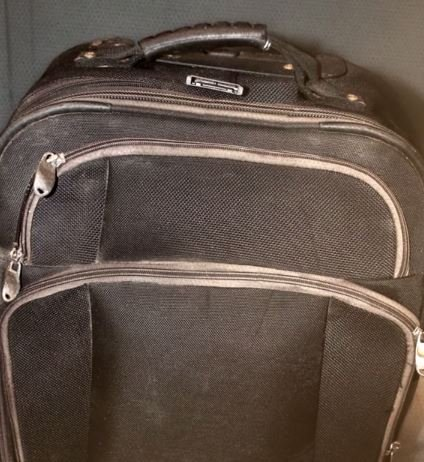 The young girl's remains were found in this black suitcase. (Source: National Center for Missing & Exploited Children)