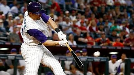 Arizona Diamondbacks' A.J. Pollock connects for a three-run double against the Colorado Rockies during the first inning of a baseball game Thursday, Sept. 14, 2017, in Phoenix. (AP Photo/Ross D. Franklin)