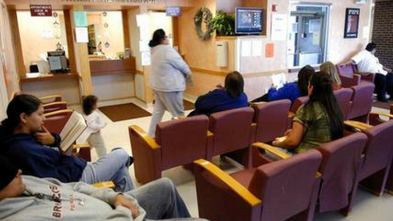 In this file photo taken Oct. 14, 2008, people sit in the Indian Health Services waiting room on Standing Rock Reservation in Fort Yates. N.D. (Source: AP Photo/Will Kincaid,File)