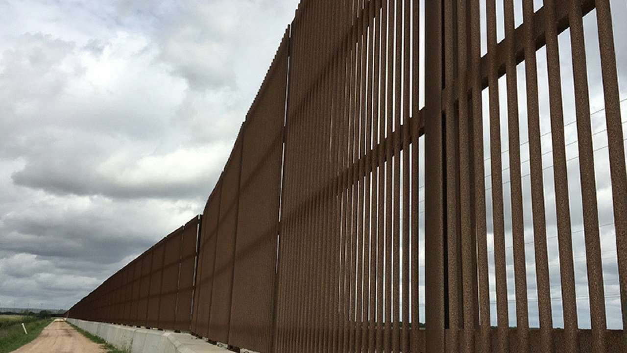 An existing stretch of border fence wall on the border near Brownsville, Texas.(Source: Mindy Riesenberg/Cronkite News)