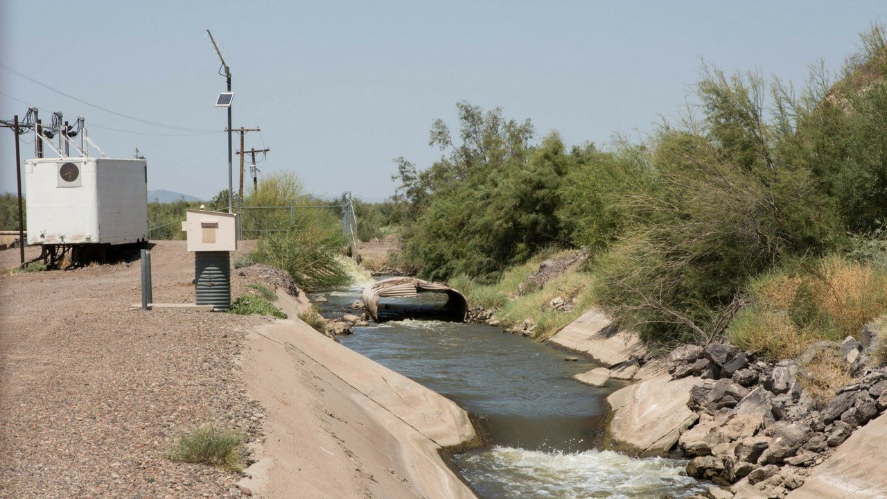 Gila River feeds into a canal near Gillespie Dam in Buckeye.(Source: Tynin Fries/Cronkite News)