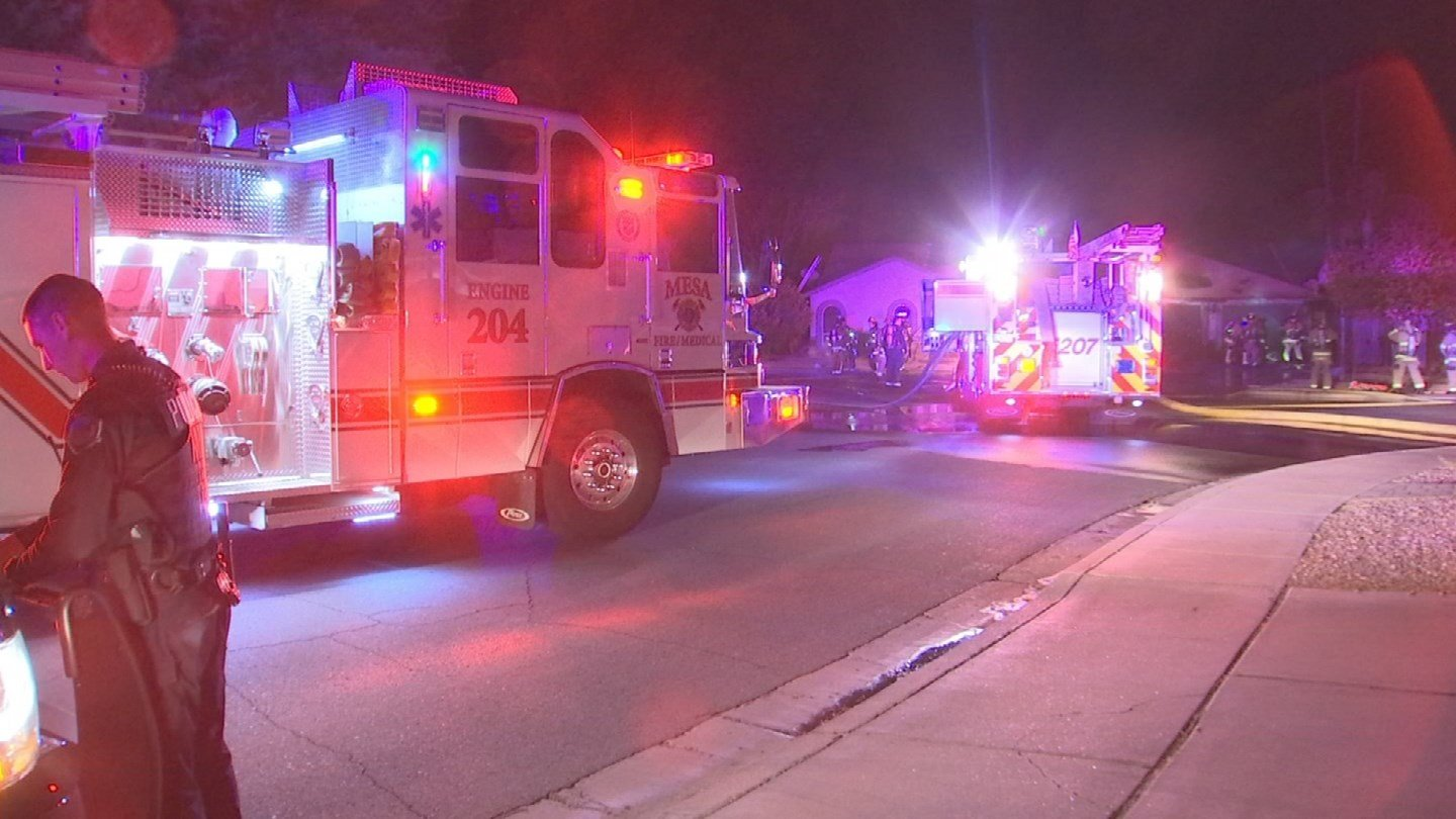 Fire crews from Chandler, Gilbert, Tempe and Mesa worked cohesively to extinguish flames from a house fire near Dobson and Baseline roads around 12:45 a.m. Monday. (Source: 3TV/CBS 5)