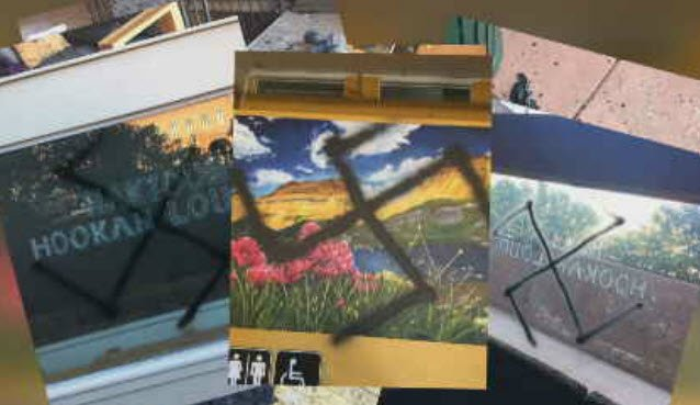 New photos show a series of swastikas sprayed on the walls and paintings inside a Flagstaff hookah lounge. (Source: 3TV/CBS 5)
