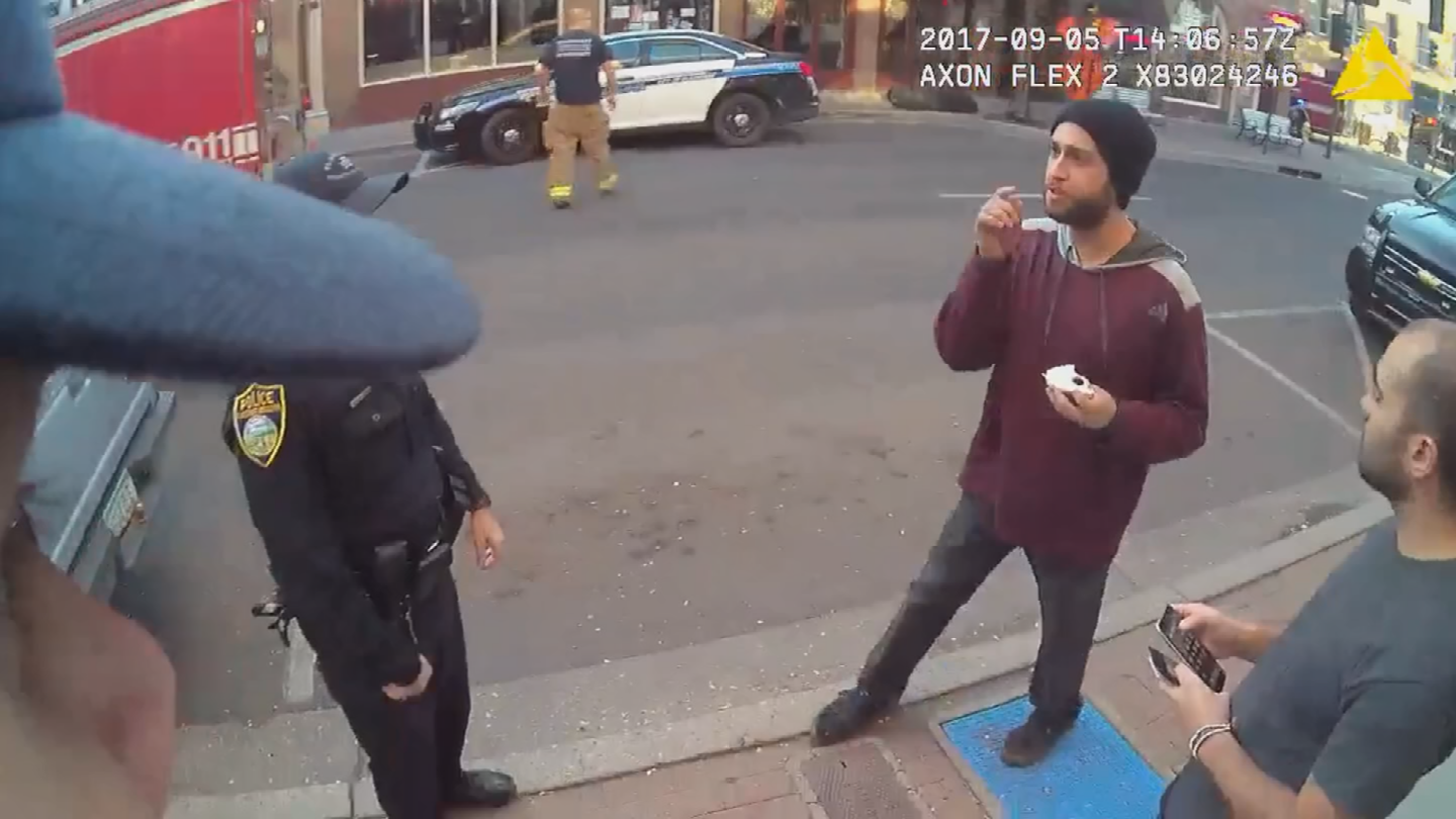 Outside of the lounge, officer body camera video shows the owner, Aaron Jasmin walking up. (Source: Flagstaff Police Department)