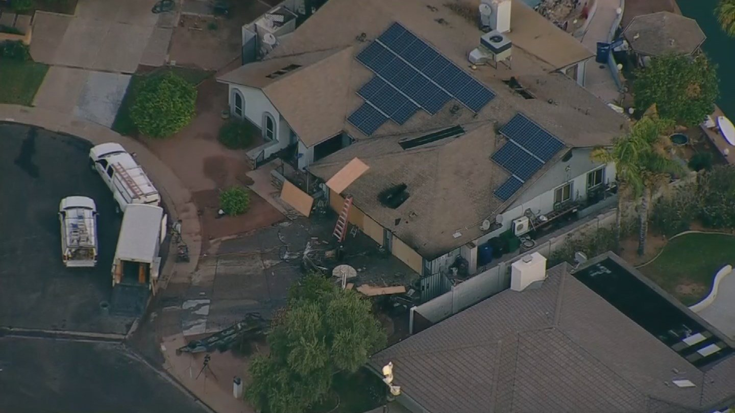 Firefighters had to deal with flames and solar panels at a Mesa house early Monday morning. (Source: 3TV/CBS 5)
