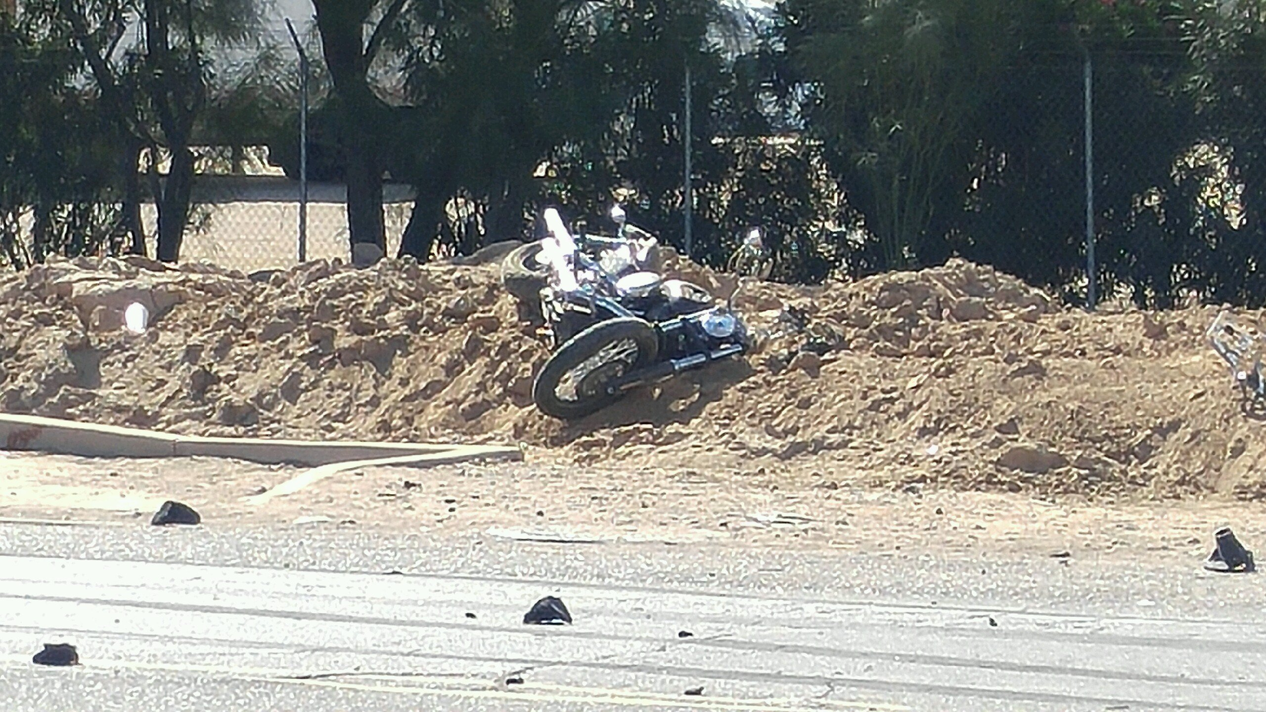 Police say Lopez, three passengers in his car and a 42-year-old man on a motorcycle were hospitalized with injuries following the crash Sunday morning that sent Lopez's vehicle into a canal. (Source: 3TV/CBS 5)